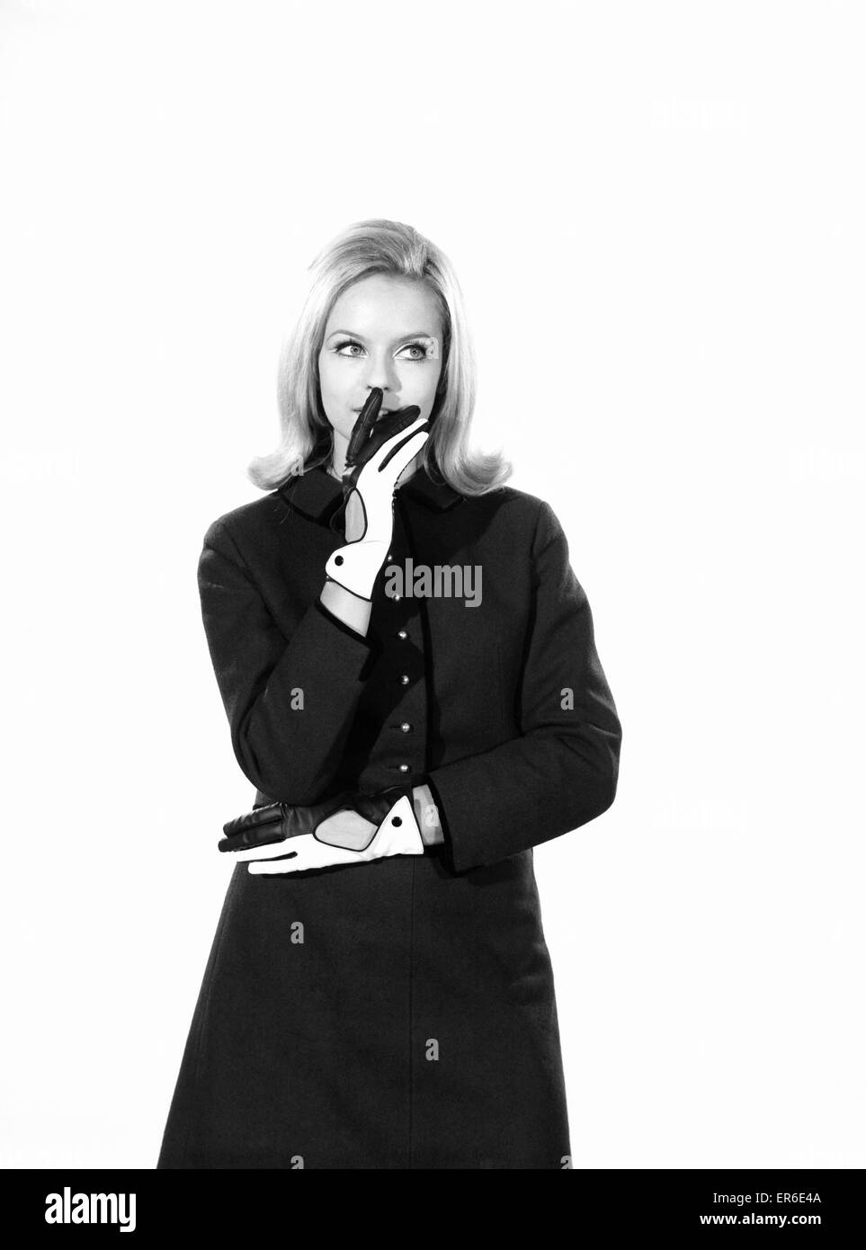 Clothing: Fashion: Gloves: Woman wearing two tone gloves. Model: Anna-Marie Greeber. 1966 B2039-001 - Stock Image