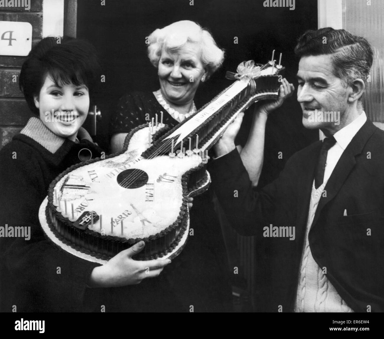 Beatle fan, Jeanette Trust 16 from West Derby, Liverpool, presents Harold and Louise Harrison, parents of George - Stock Image