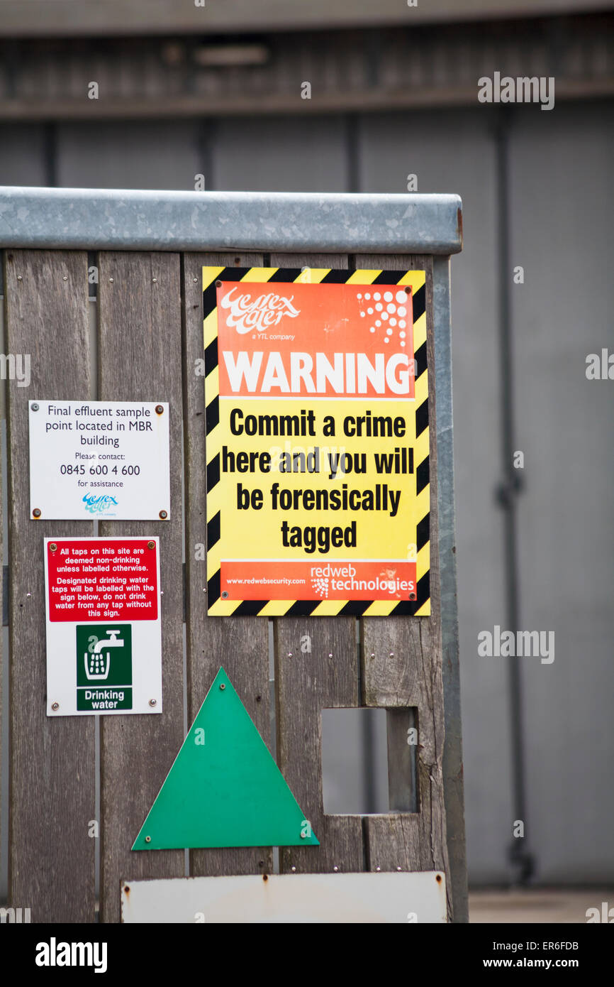 Warning Commit a crime here and you will be forensically tagged - Wessex Water sign at Swanage Stock Photo
