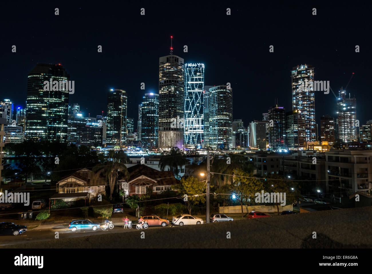 Brisbane City Skyline behind houses - Stock Image