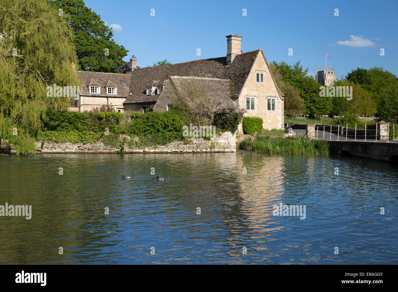 River Coln and Fairford church, Fairford, Cotswolds, Gloucestershire, England, United Kingdom, Europe - Stock Image