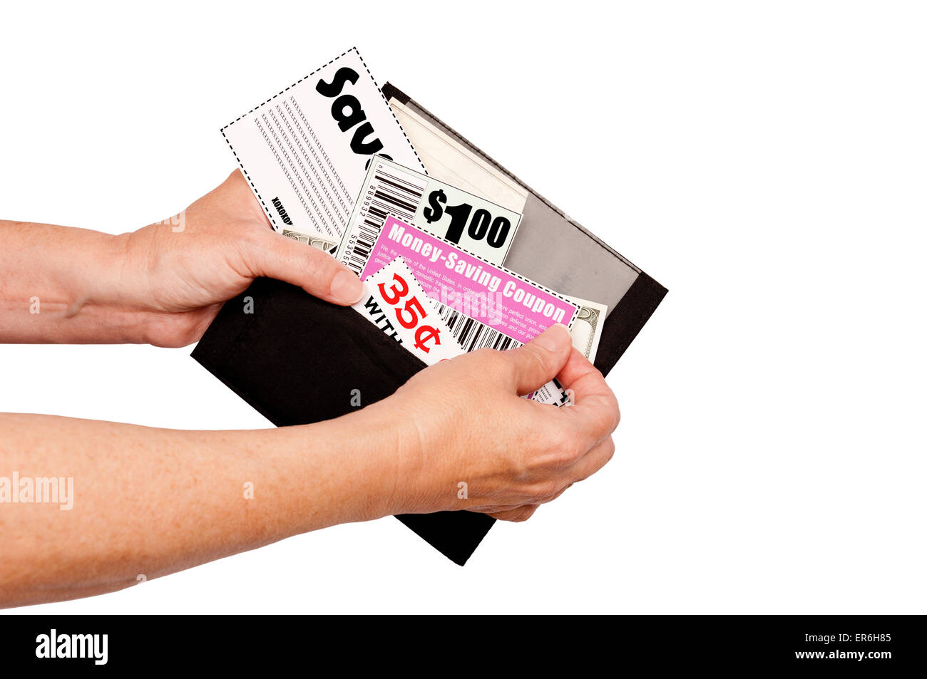 Thrifty Shopper Using Coupons..Hands taking coupons from wallet. - Stock Image