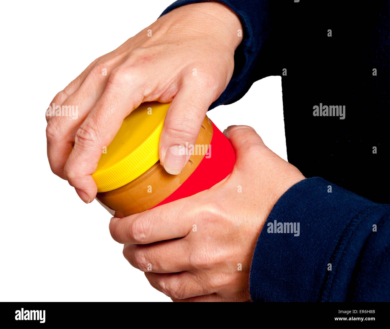 Trying to open a jar with arthritis pain. Horizontal shot on white background - Stock Image