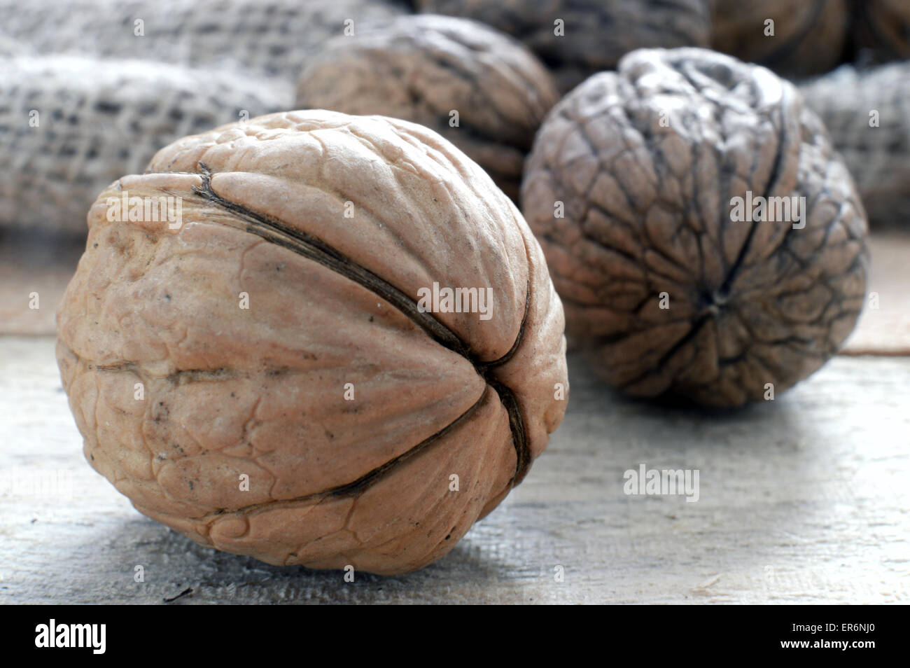 Some walnuts on a sack in a rustic kitchen, macro - Stock Image