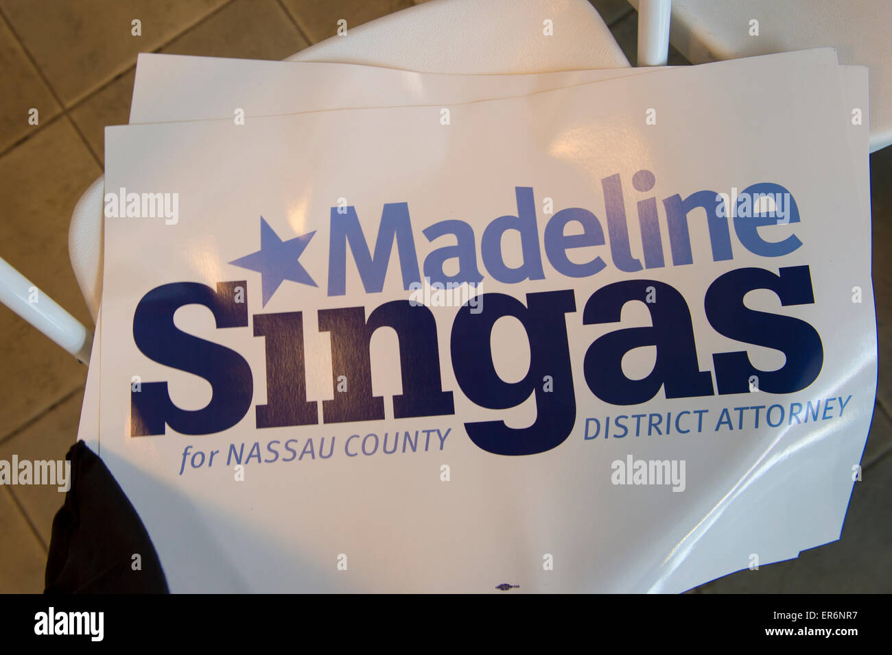 Garden City, New York, USA. 26th May 2015. At end of Nassau County Democrats nominating convention, a sign for Madeline - Stock Image