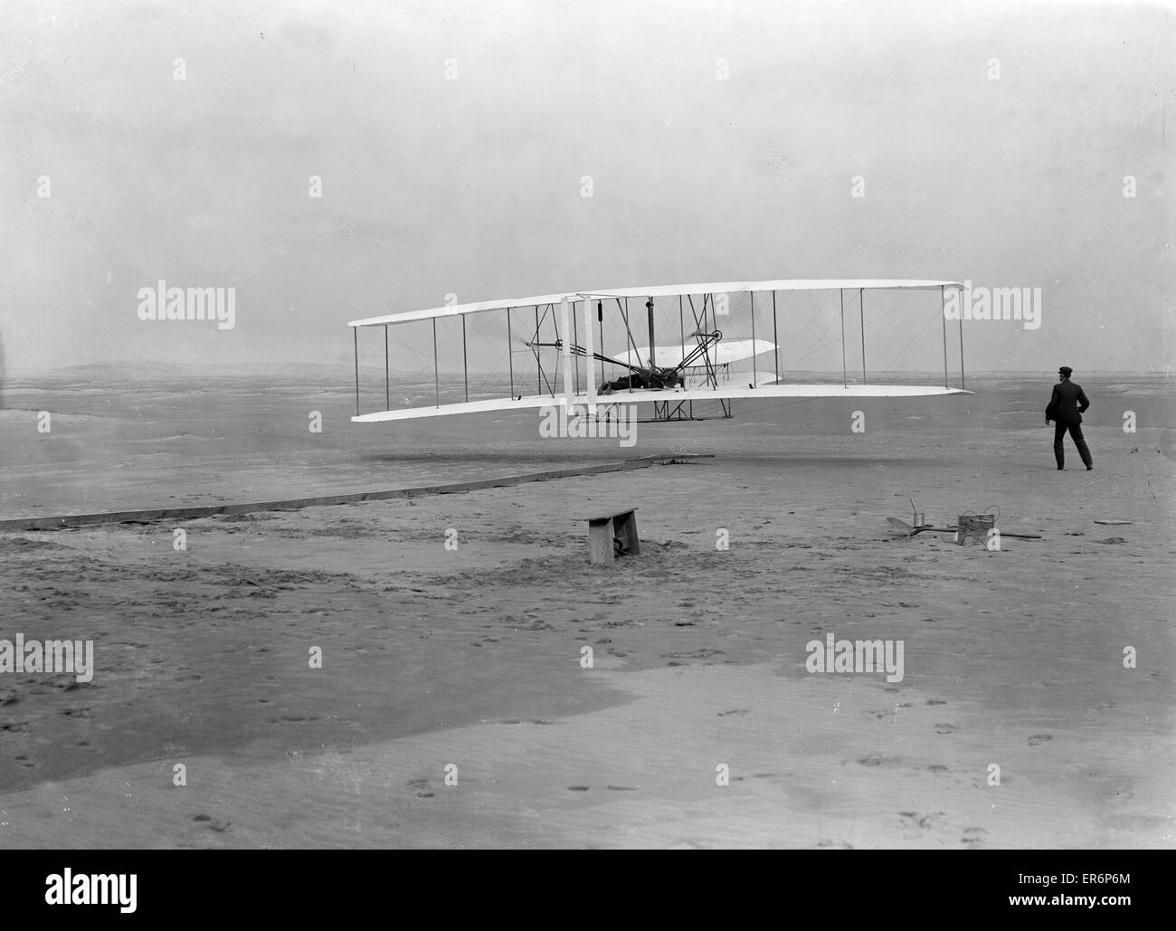 First flight, 120 feet in 12 seconds, 10:35 a.m.; Kitty Hawk, North Carolina. Photograph shows the first powered, - Stock Image