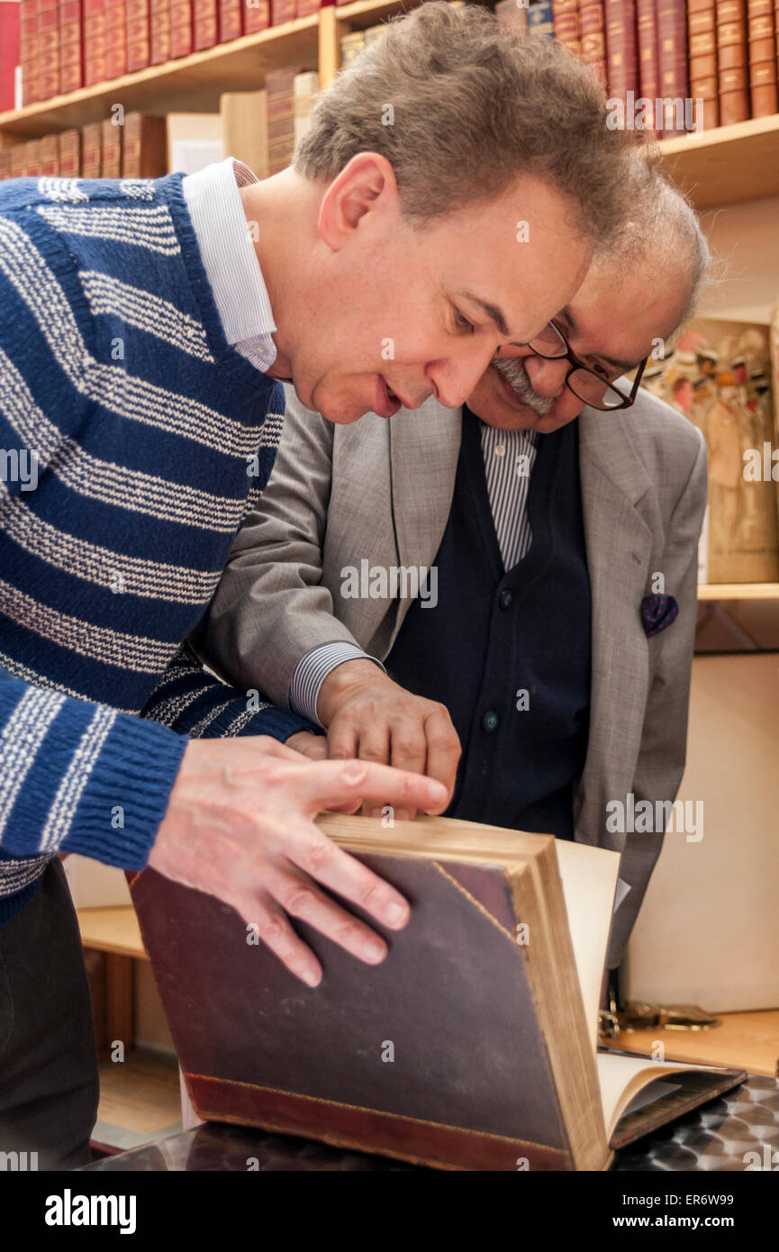 London, UK. 28 May 2015. Book seller meets client, as literary fans and collectors gather for the 58th London International - Stock Image