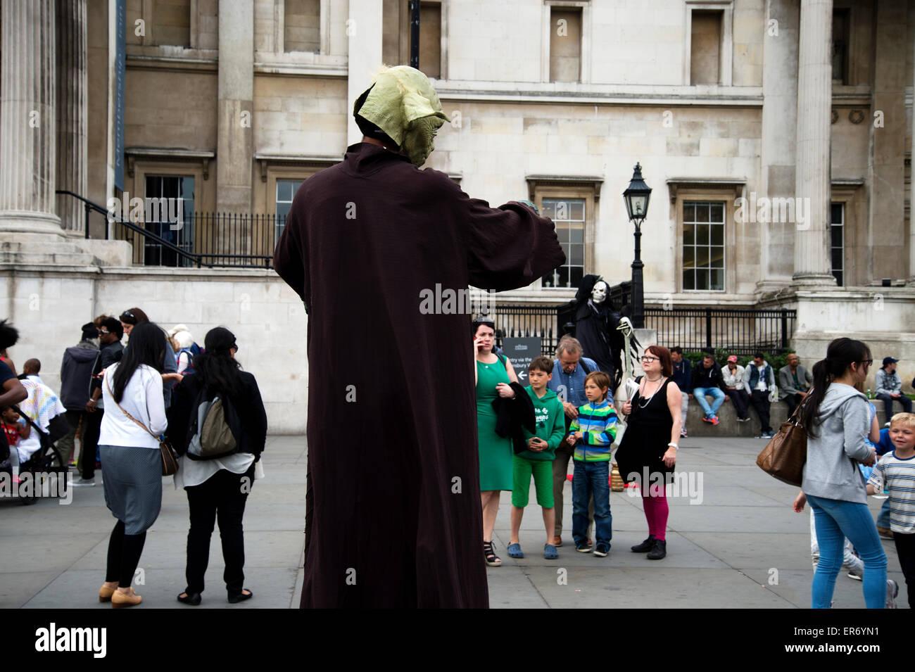 Trafalgar Square. Street entertainers pose for tourists - Stock Image