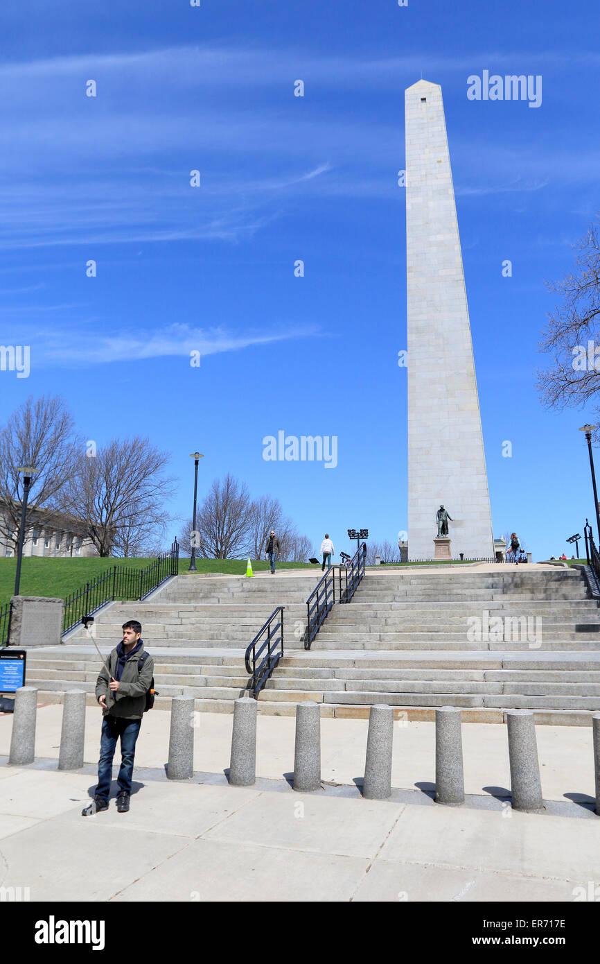 Boston Freedom Trail landmark selfie with man and selfie stick. Bunker Hill monument in Boston Massachusetts good - Stock Image