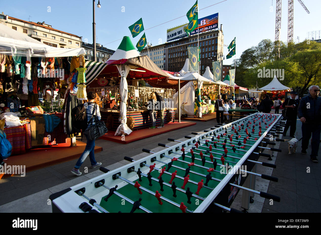 Giant Fussball game table at market in front of Milano railroad station, Italy - Stock Image