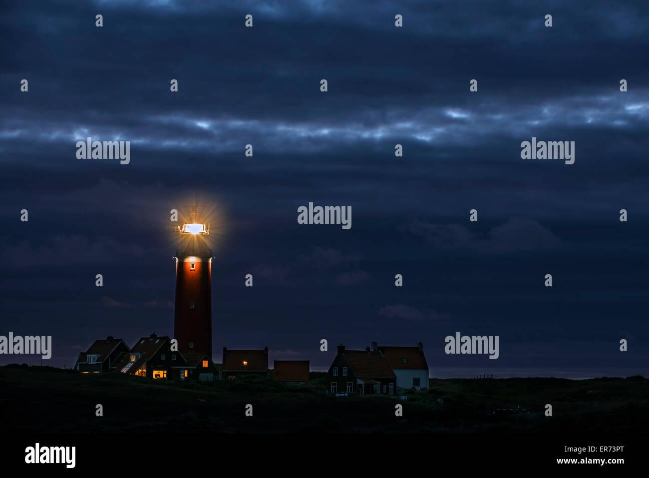 Eierland Lighthouse with light of lantern shining over