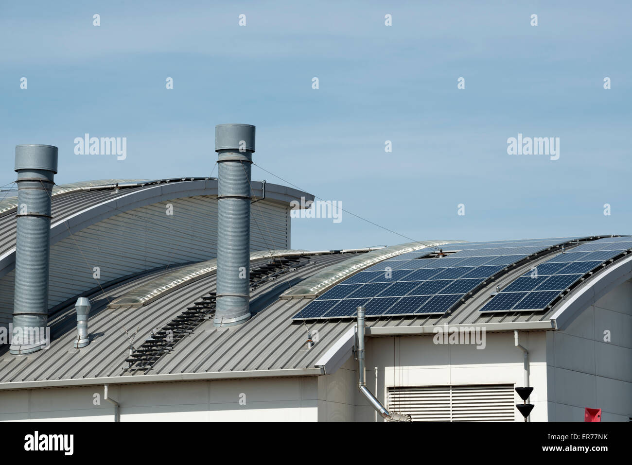Solar panels on a Trinity House warehouse, Harwich, Essex, UK. - Stock Image