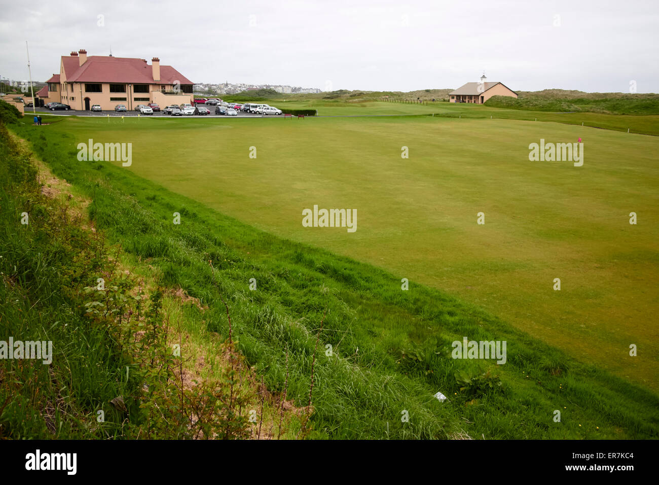 Royal Portrush Golf Club practice green and clubhouse Northern Ireland - Stock Image