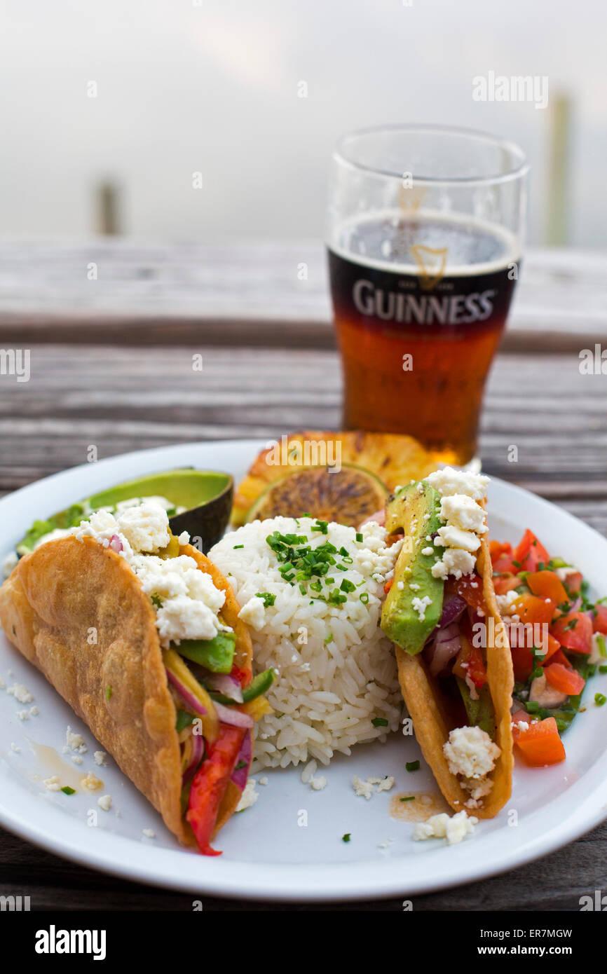 Apalachicola, Florida - Tacos and beer at Up the Creek Raw Bar. - Stock Image
