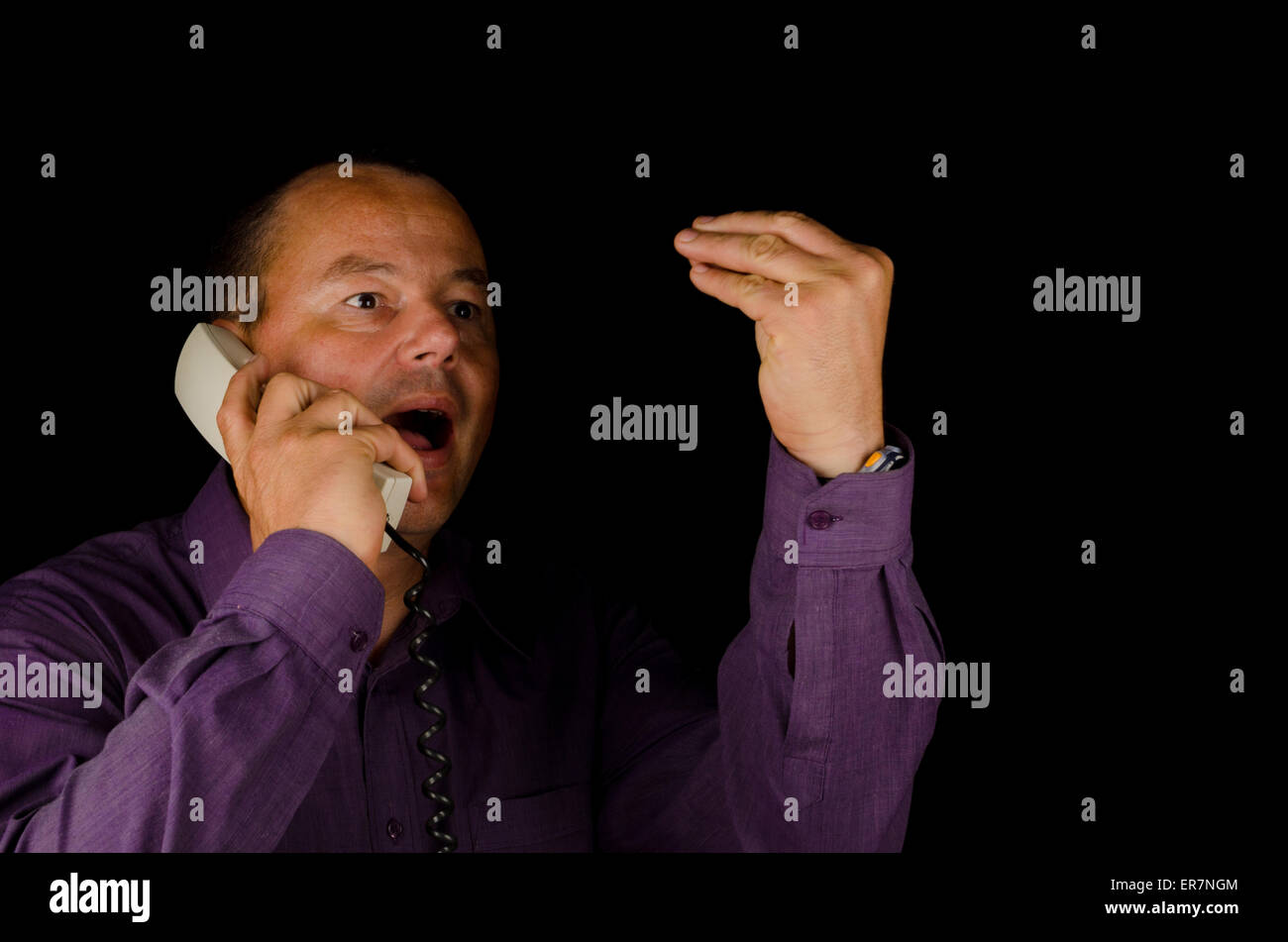 Guy becoming lound and obnoxious on the telphone - Stock Image
