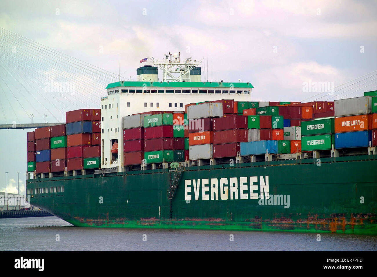 A close-up view of the stern of a huge container ship leaving the big and busy Port of Savannah in Georgia, USA. - Stock Image