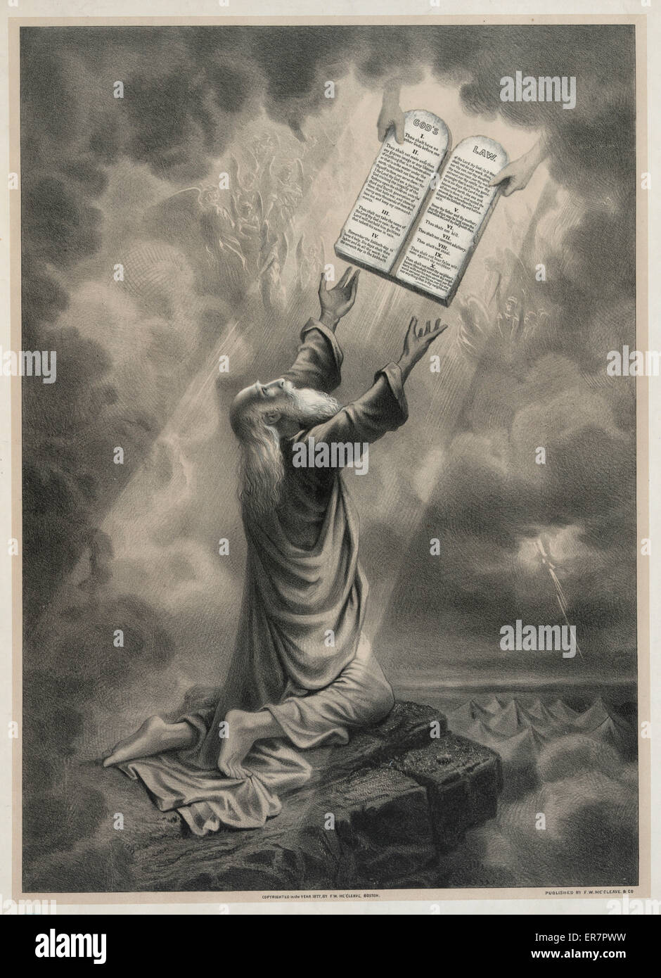 Moses receiveing the law. Print shows Moses kneeling and reaching upwards to accept the tablets inscribed with theTen Commandments from the hands of God. Angels can be seen in the heaven. Date c1877. Stock Photo
