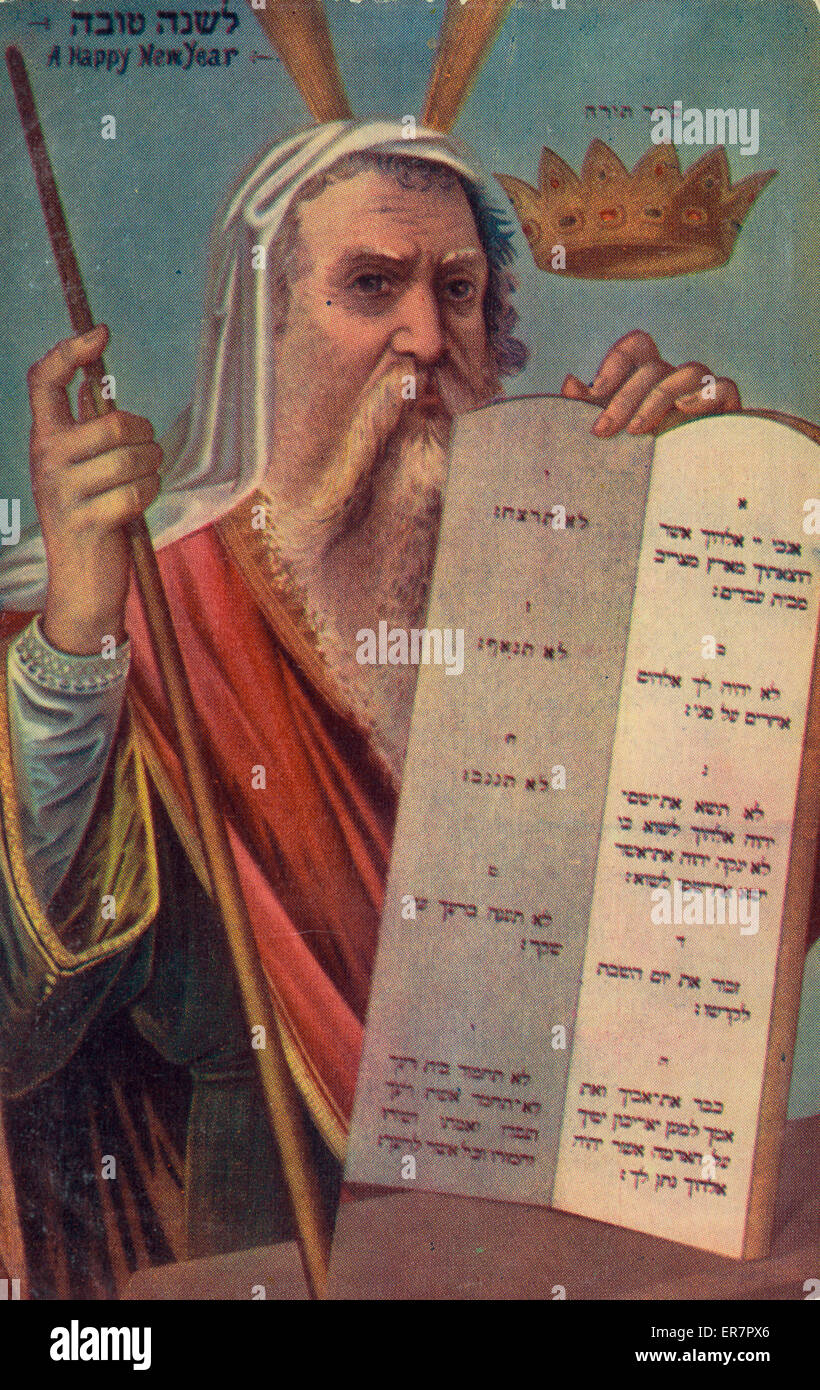 A happy new year. Print shows Moses holding the Ten Commandment tablets. Date between 1900 and 1920. - Stock Image