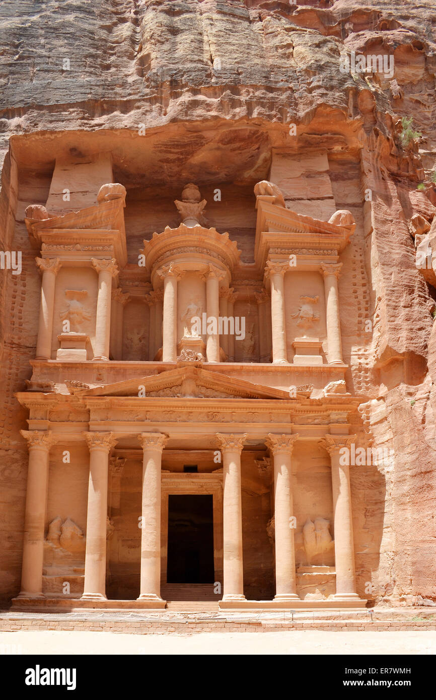 PETRA, JORDAN - MAY 19, 2015: The treasury of the Nabataean ancient city of Petra, Khazna in Arabic. Petra is one - Stock Image