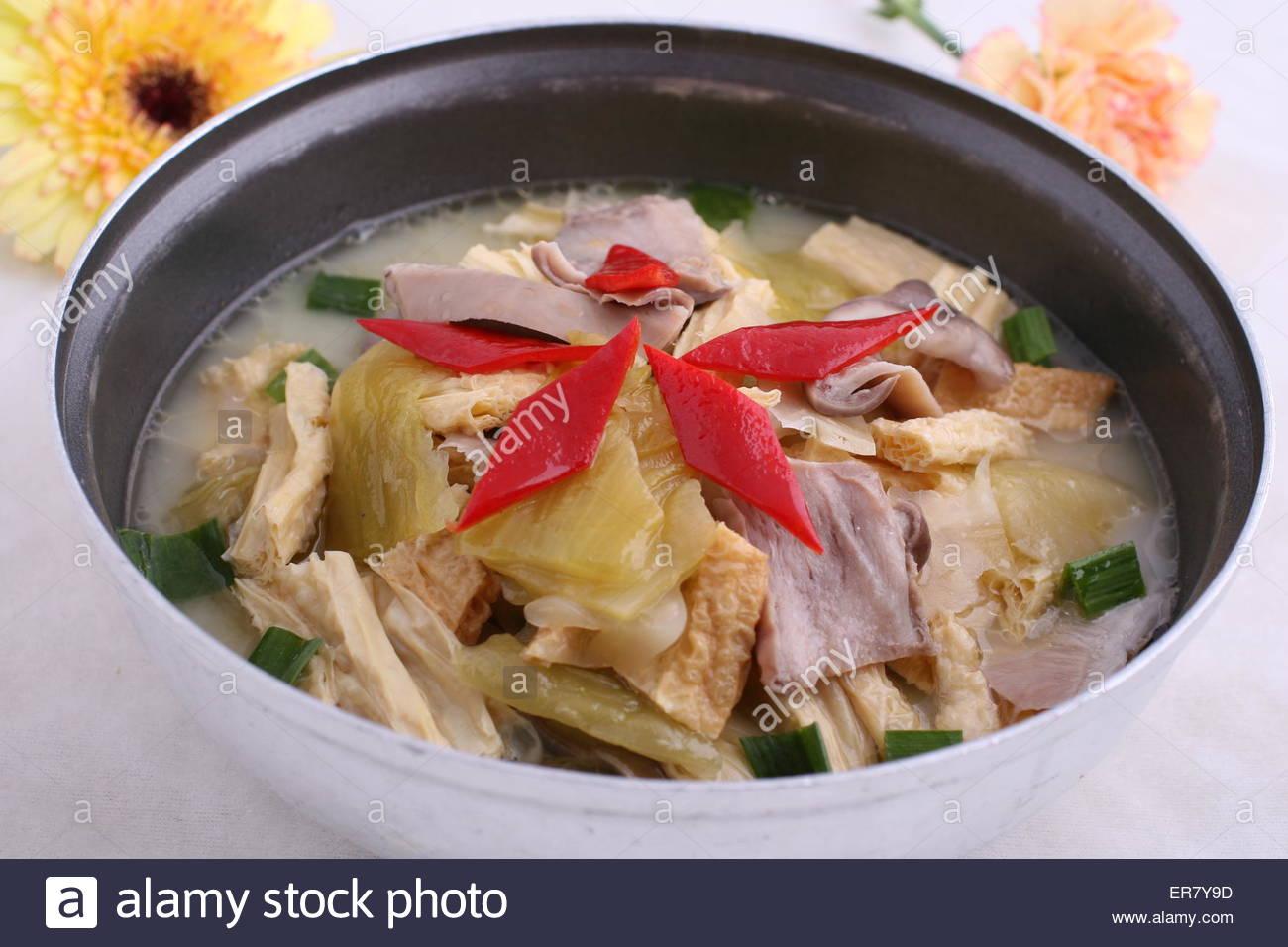 Dry pot pickled pork bellies - Stock Image