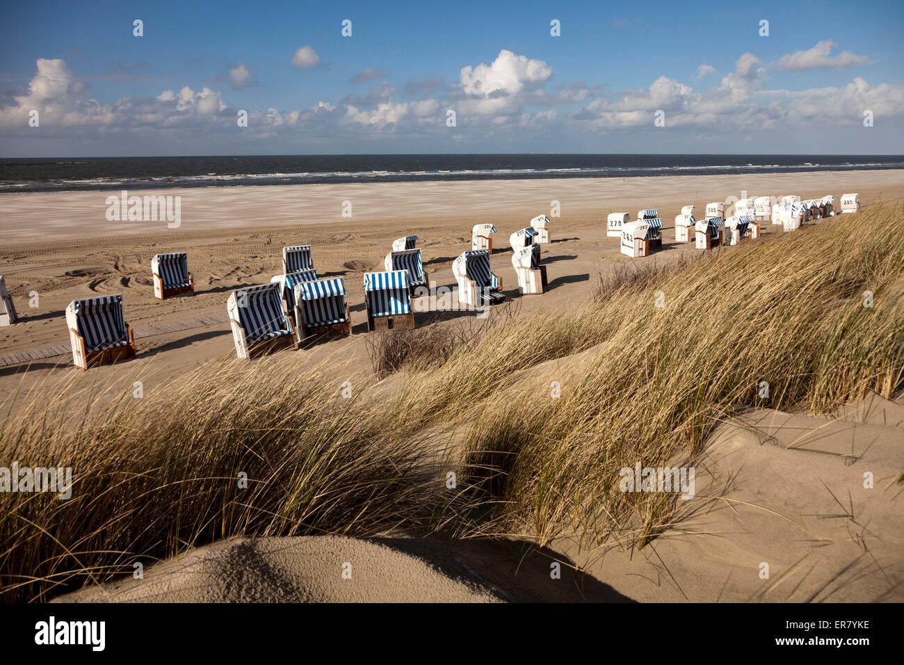 Strandkorb - beach chairs on the main beach, East Frisian Island Spiekeroog, Lower Saxony, Germany Stock Photo