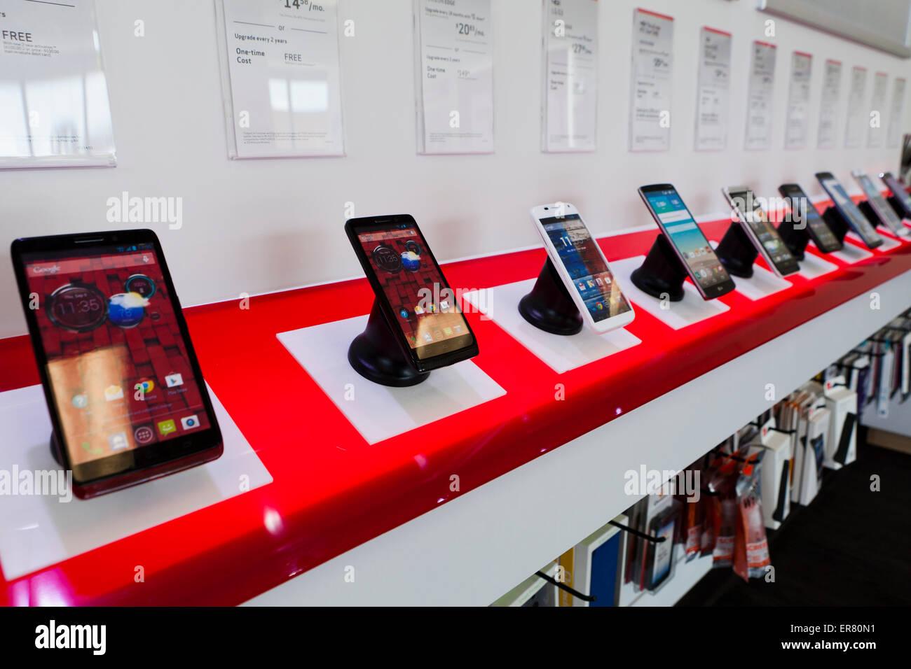 Mobile pads and phones on display at Verizon store - USA Stock Photo