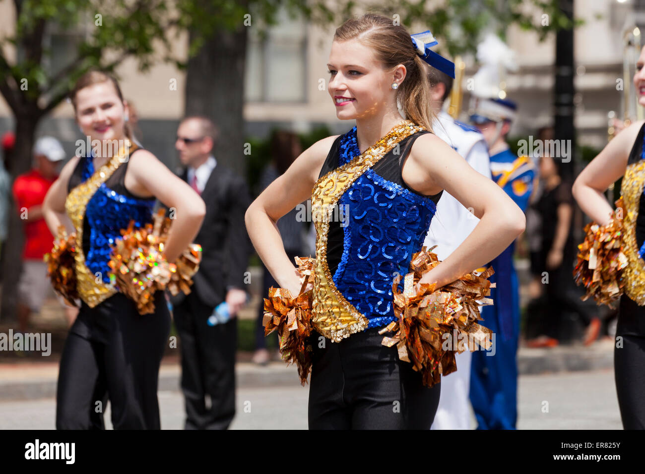 Young Caucasian high school cheerleaders in parade - USA - Stock Image
