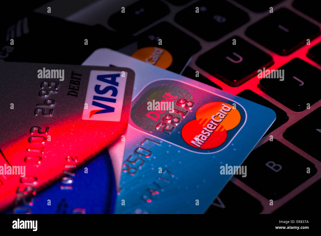 Credit card on computer keyboard - USA - Stock Image