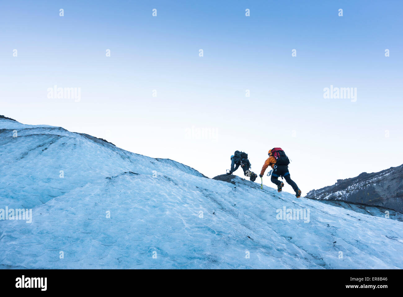 Two climbers on an Icelandic glacier. - Stock Image