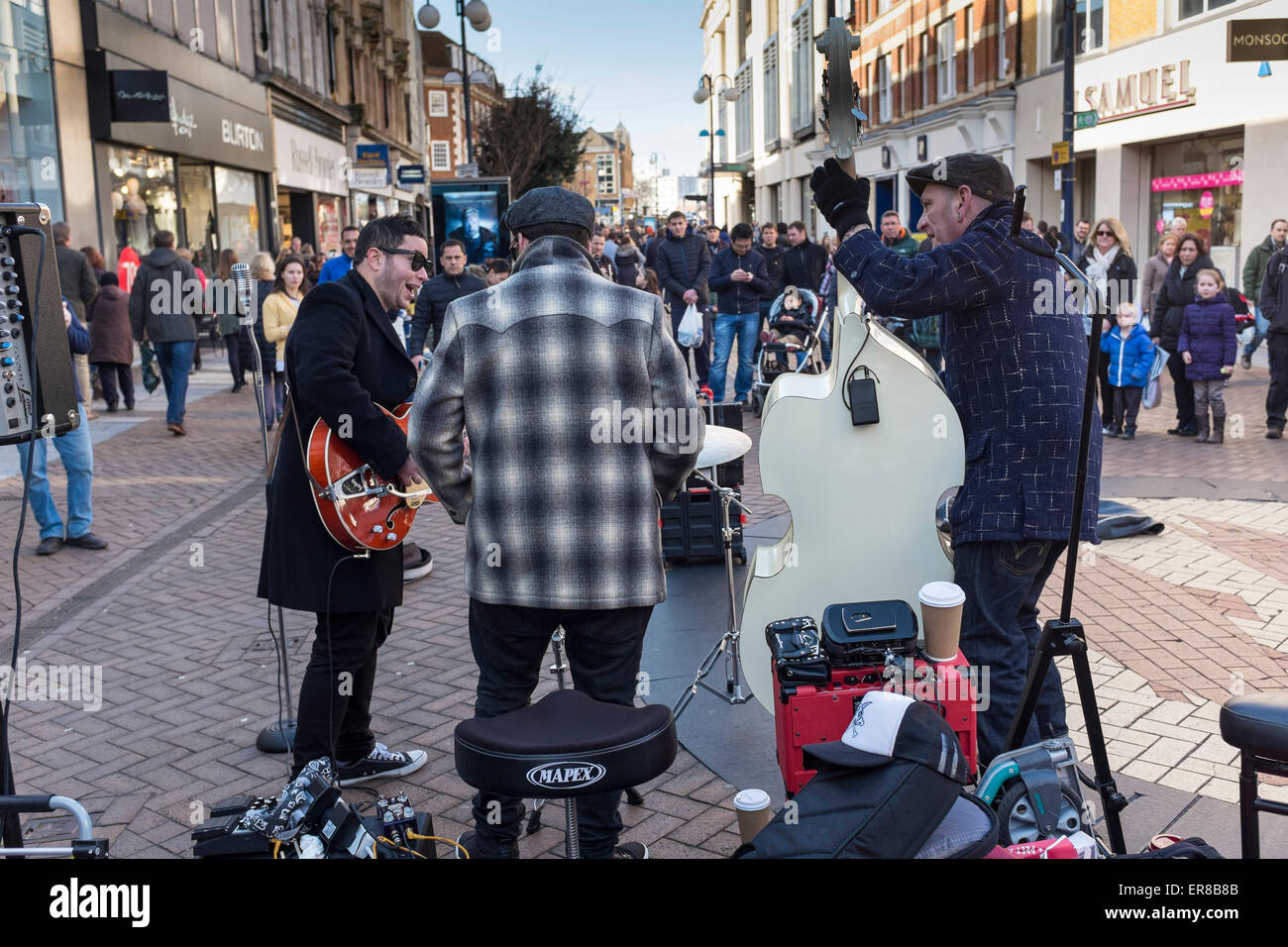 Buskers singing and playing musical instruments, KIngston upon Thames, Surrey, UK Stock Photo