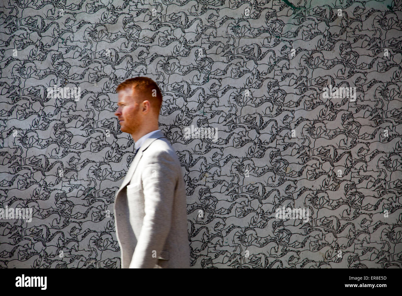 Man Passes Horse Illusion Wallpaper in Soho - London UK - Stock Image