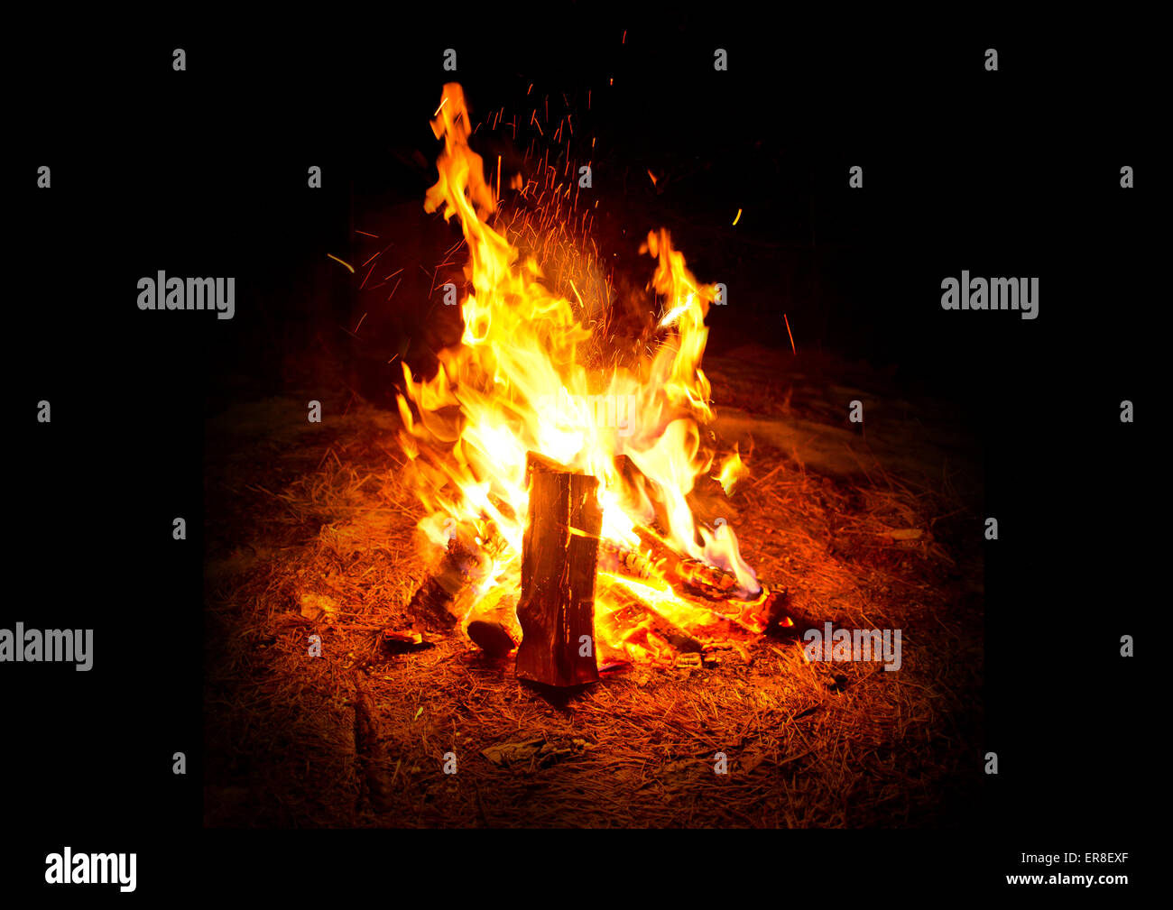 Camping Fire. A warm glowing camp fire at night. - Stock Image