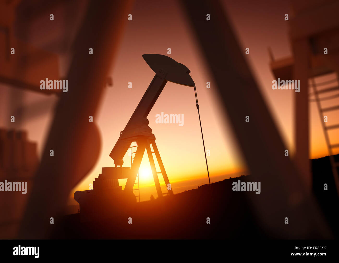 Oil and Energy Industry. A field of oil pumps against a sunset. Oil prices, energy and economic commodities. - Stock Image