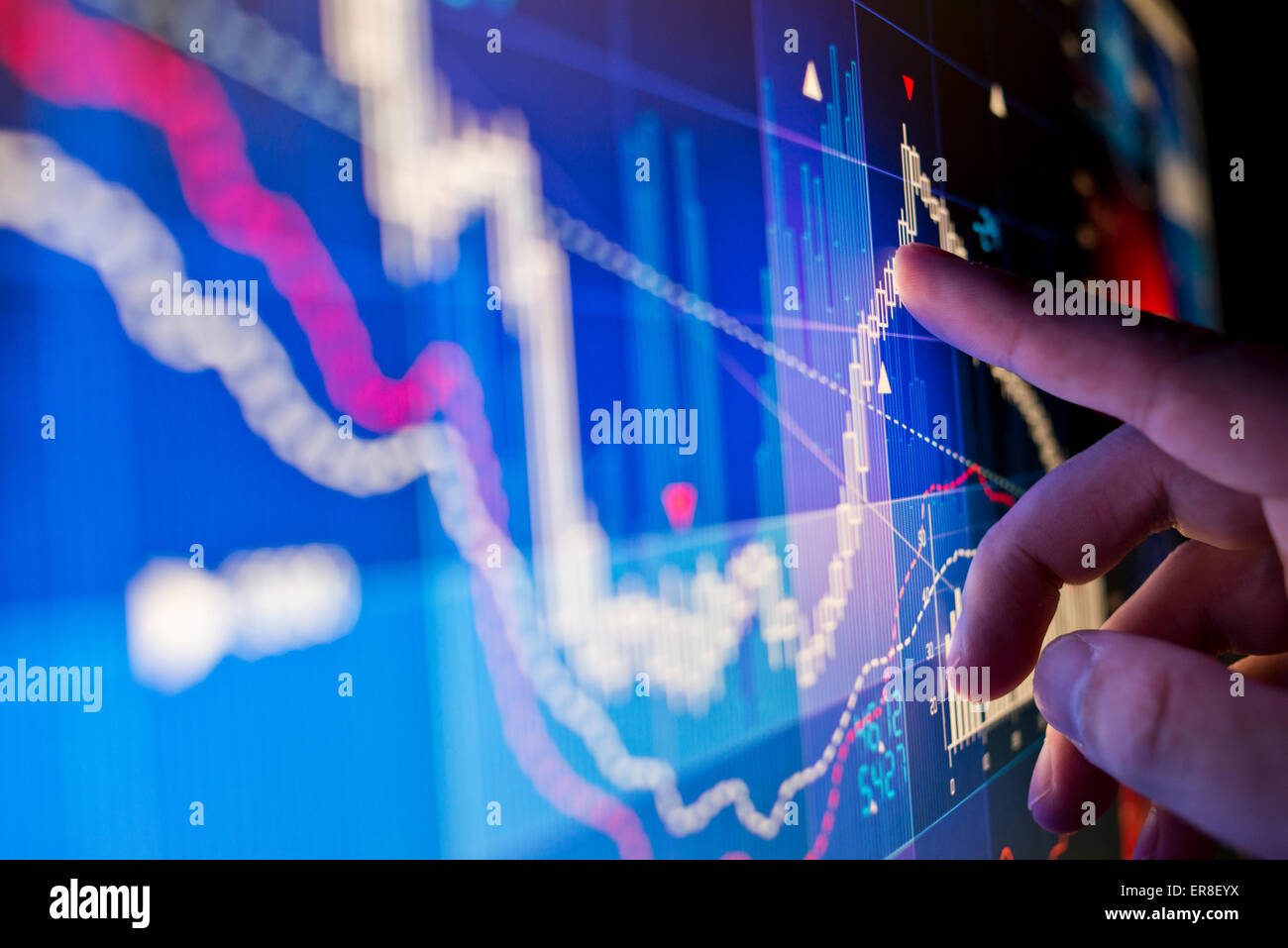 A city worker Analyzing stock market data on a monitor. - Stock Image