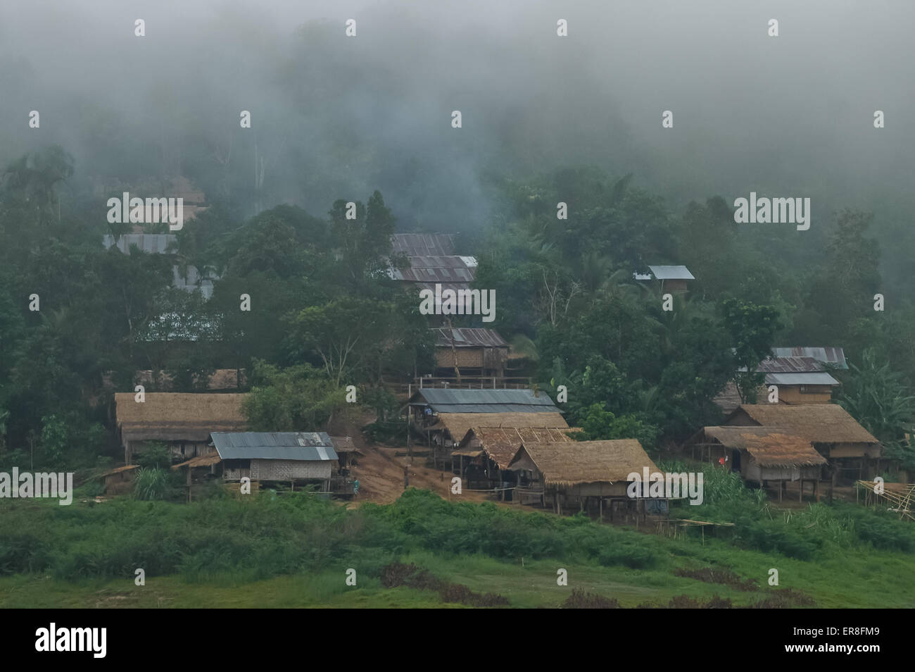 Rural hut cottages in a country village in Thailand. - Stock Image