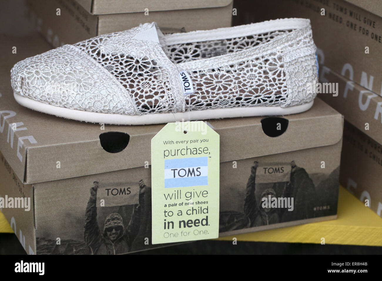 TOMS footwear for sale in a shop in Wirksworth - Stock Image