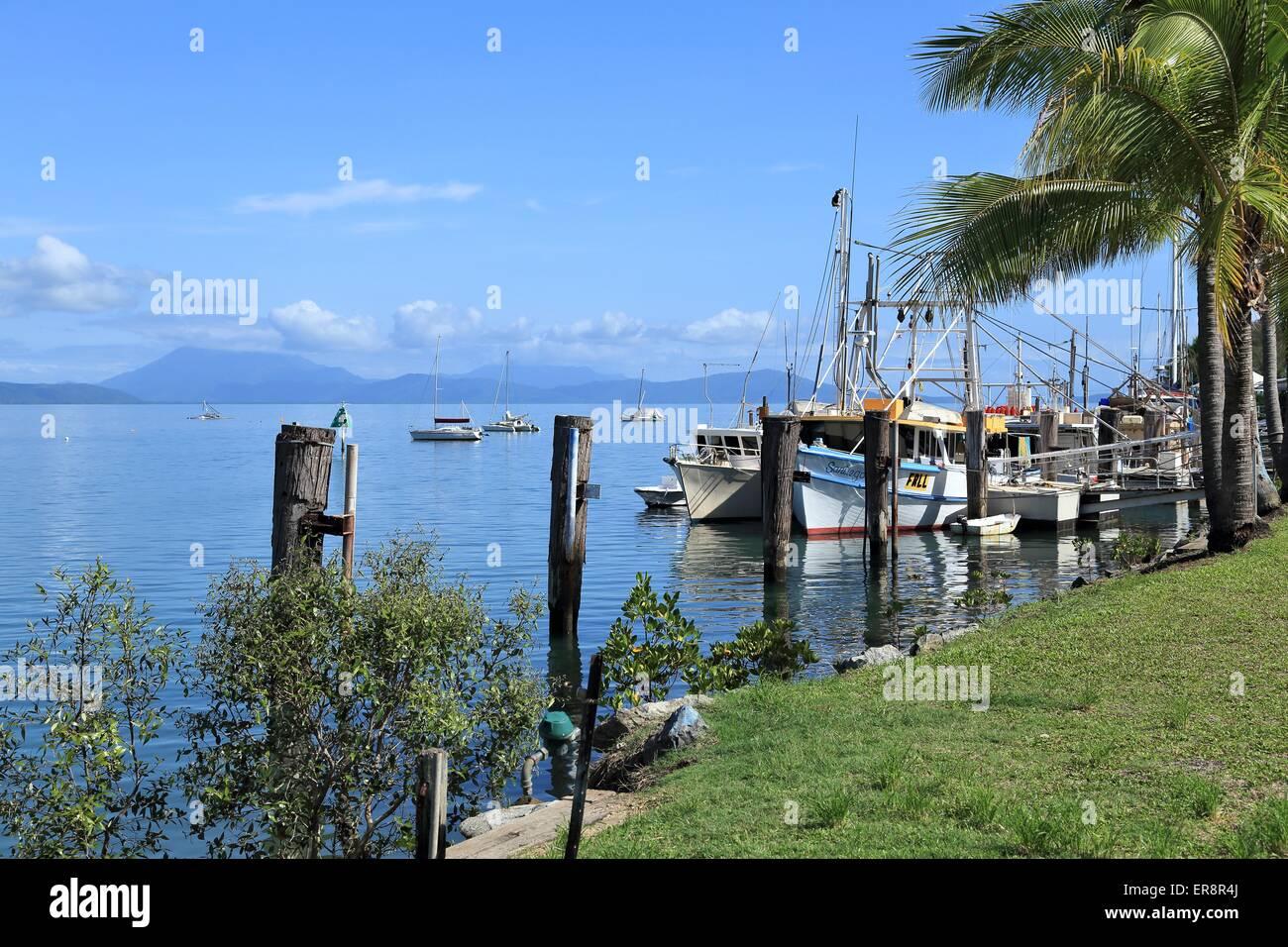 Beautiful reflections of boats moored at the Port Douglas Marina, Port Douglas, Queensland, Australia - Stock Image
