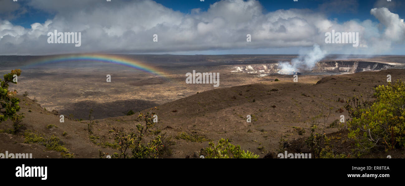 Kilauea volcano, Hawaii Island - smoking with a rainbow drifting by, Hawaii, USA - Stock Image