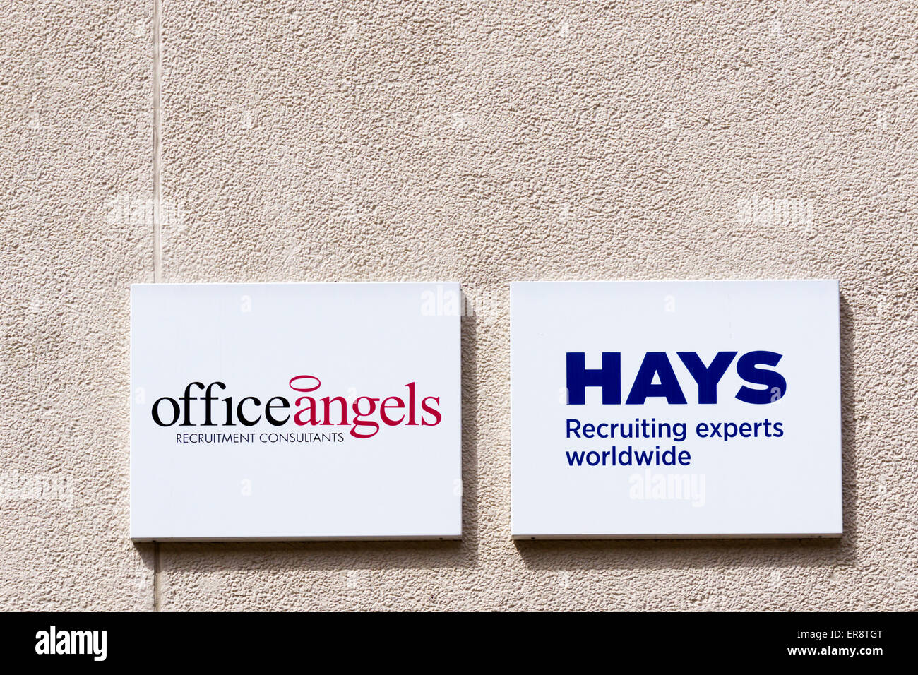 Signs for recruitment agencies, Office Angels and Hays. - Stock Image