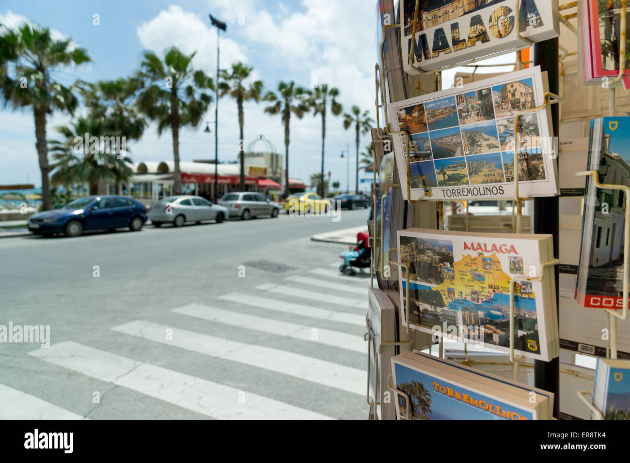 A postcard rack of postcards of Malaga and Torremolinos on the seafront in Torremolinos, Malaga, Spain - Stock Image