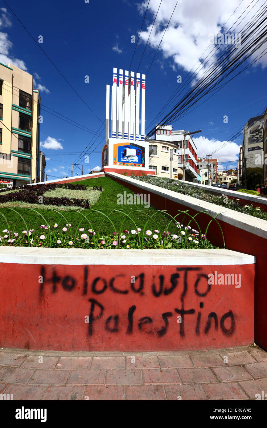 The words Palestine Holocaust and a defaced monument in protest against the Israeli military offensive in Gaza, - Stock Image