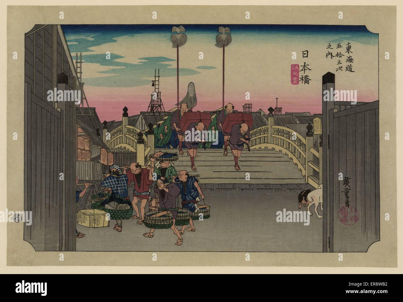 Nihonbashi. Print shows porters carrying bundles across the Nihon Bridge on the Tokaido Road. Date between 1830 - Stock Image