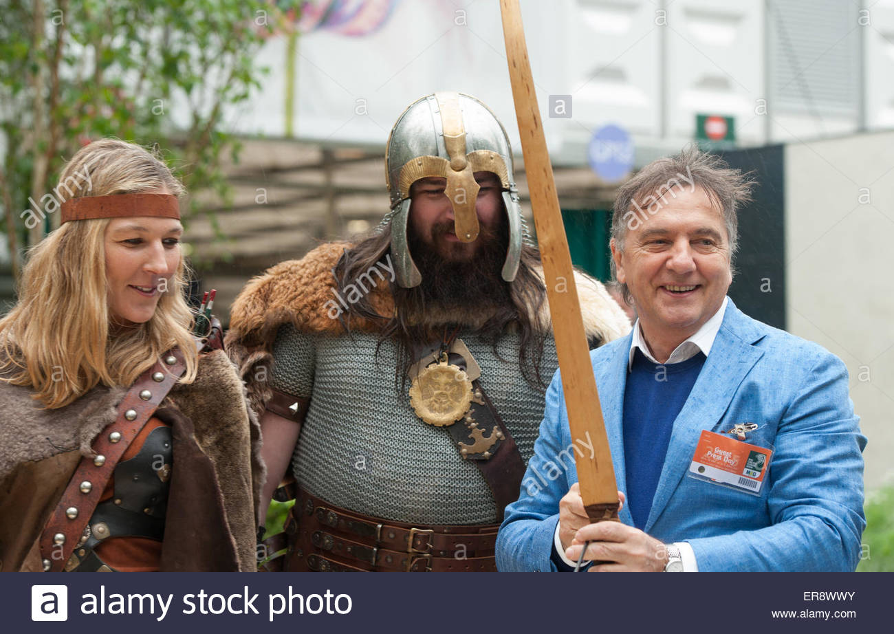 London UK 18th May 2015  RHS Chelsea Flower Show press day. Celebrity chef Raymond Blanc armed with a viking sword. - Stock Image