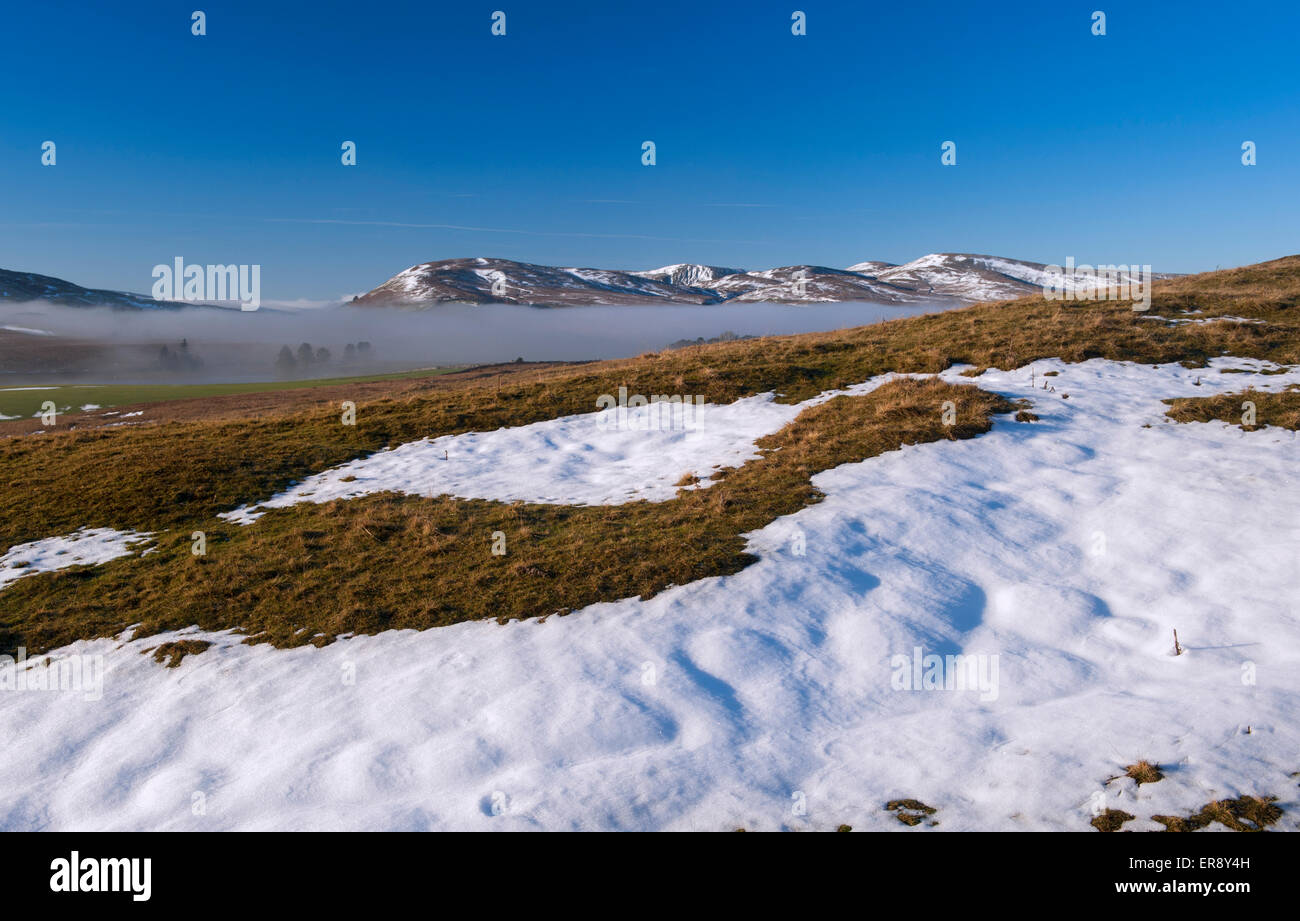 Freezing fog lingering in valley bottoms on a  winter morning, looking towards the Howgill Fells, Cumbria, UK. - Stock Image
