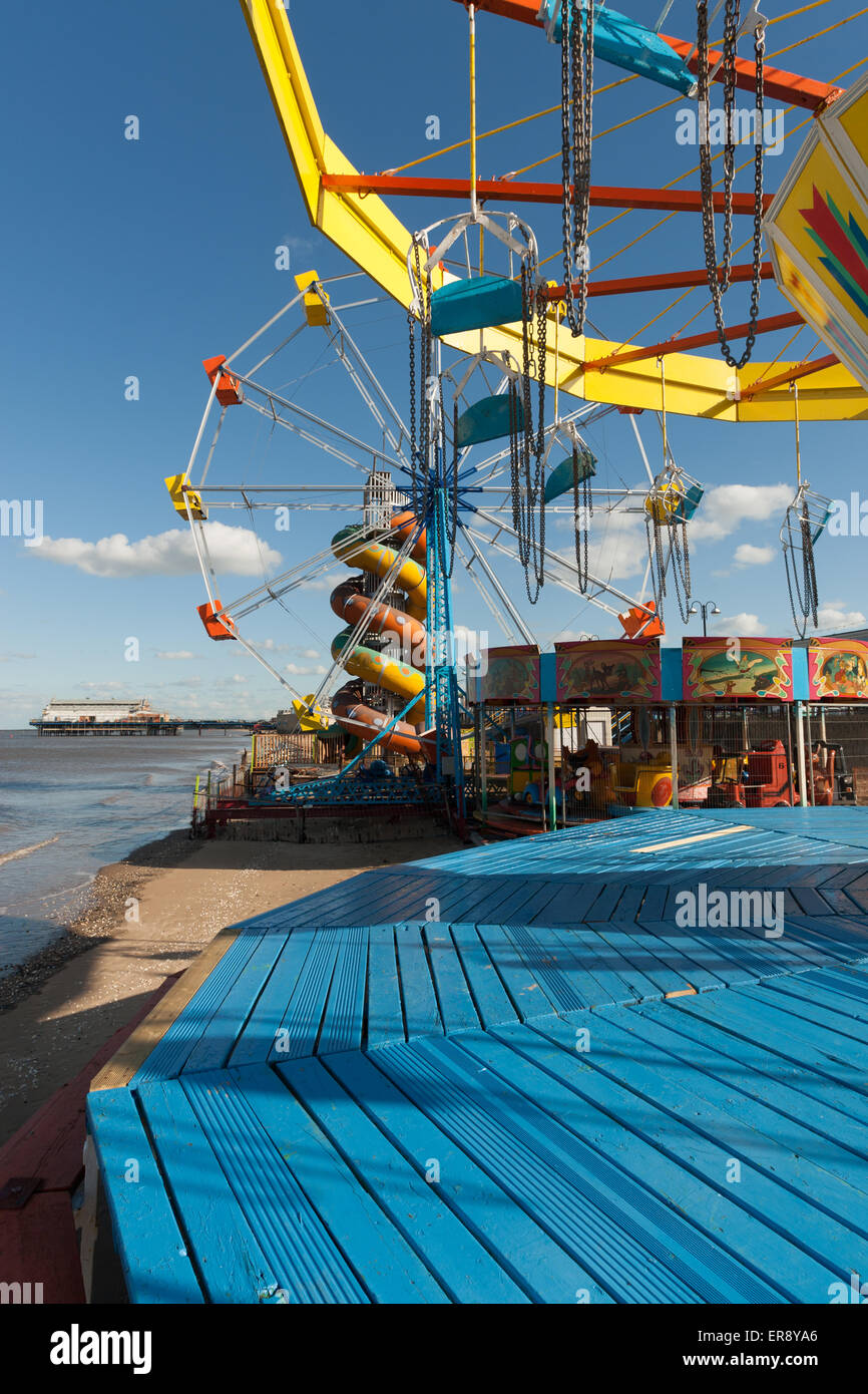 dilapidated funfair and seaside pier - Stock Image