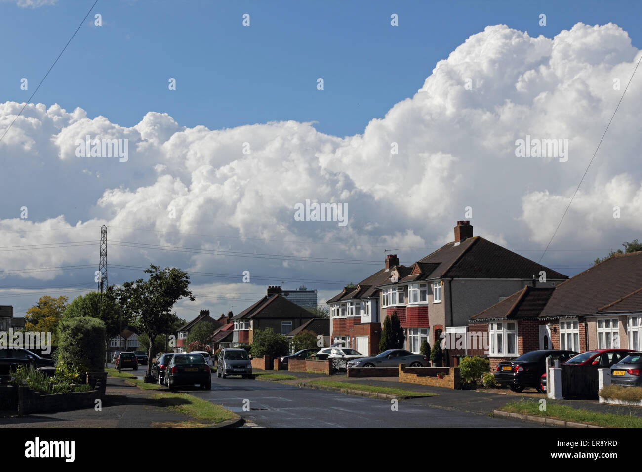 Epsom Surrey England. 29th May 2015. On a day of rain, followed by sunshine and showers, towering cumulonimbus storm - Stock Image