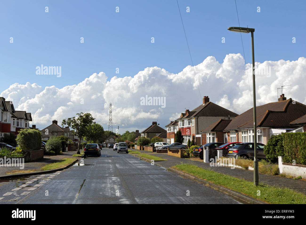 Epsom Surrey England. 29th May 2015. On a day of rain, followed by sunshine and showers towering cumulonimbus storm - Stock Image