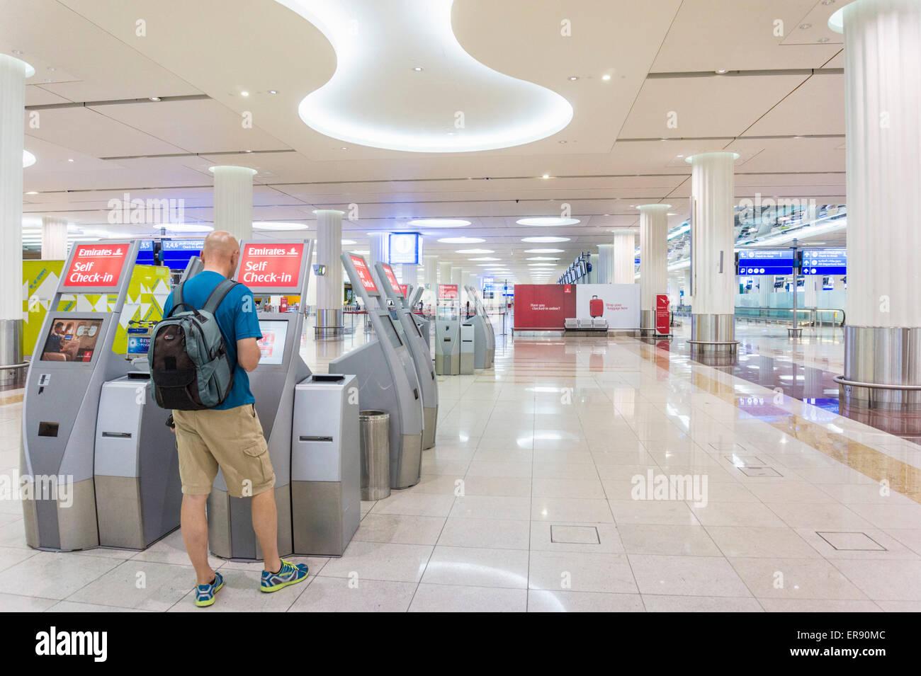 Airport check in at Dubai Airport, Dubai City, United Arab Emirates, UAE, Middle east - Stock Image