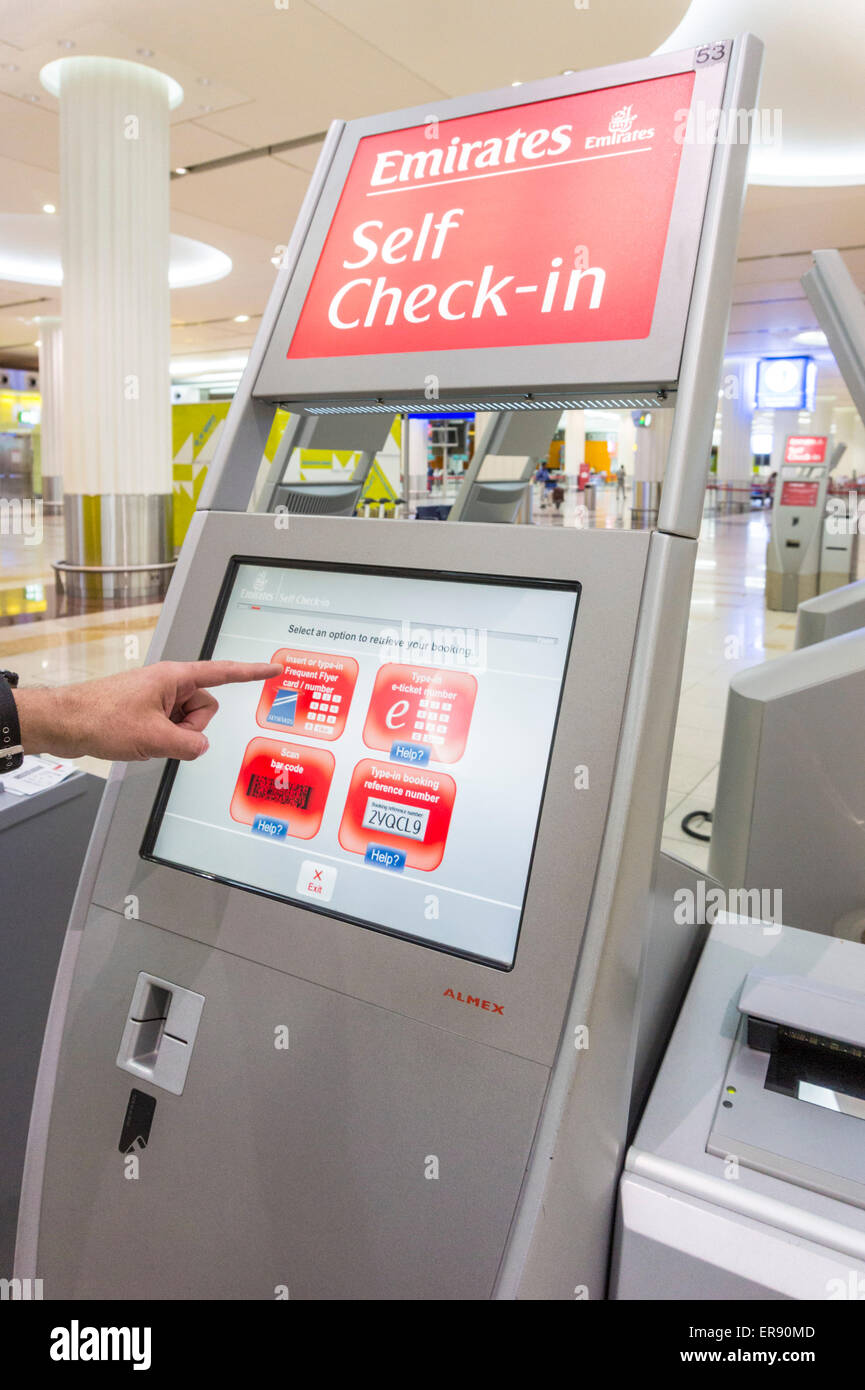 Emirates self check in machine at Dubai International Airport,  Dubai City, United Arab Emirates, UAE, Middle east - Stock Image