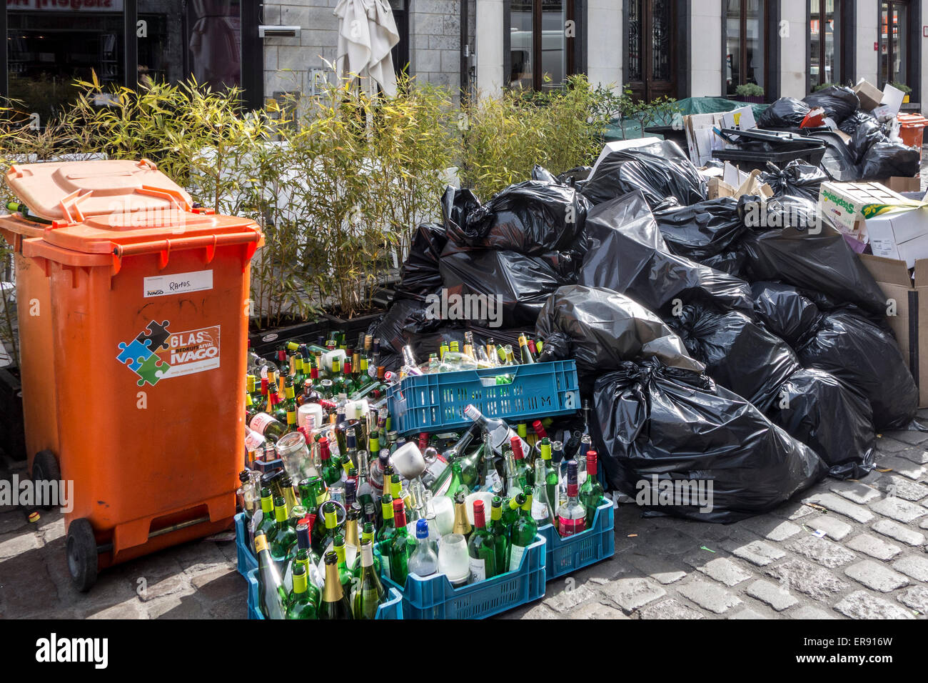 Rubbish bags and garbage containers with household refuse due to strike by the waste processing firm IVAGO in Ghent, - Stock Image